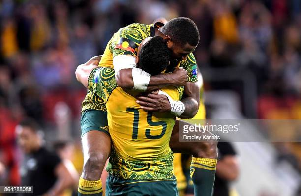 Marika Koroibete and Israel Folau of the Wallabies celebrate victory after the Bledisloe Cup match between the Australian Wallabies and the New...