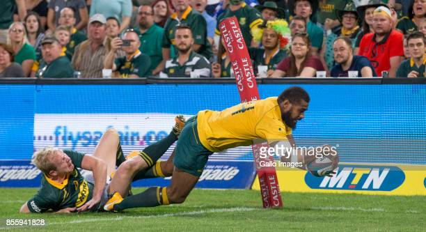 Marika Koroibete of Australia dives over to score despite the tackle from Ross Cronje of the Springboks during the Rugby Championship 2017 match...