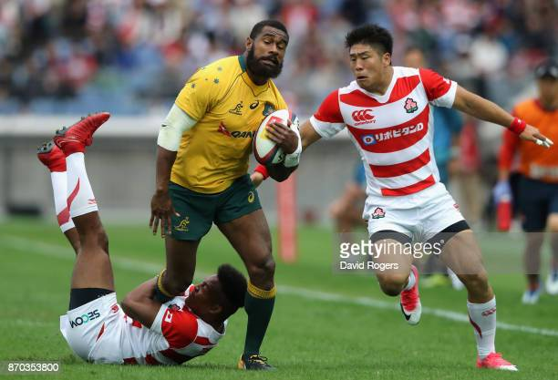 Marika Koroibete of Australia is tackled by Kotaro Matsushima and Rikiya Matsuda during the rugby union international match between Japan and...