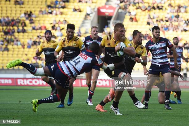 Marika Koroibete of the Melbourne Rebels and Brad Shields of the Hurricanes during the round two Super Rugby match between the Hurricanes and the...