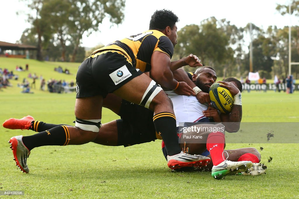 Marika Koroibete of the Rising gets tackled by Marcel Brache and Onehunga Havili of the Spirit during the round one NRC match between Perth Spirit and Melbourne Rising at McGillivray Oval on September 3, 2017 in P