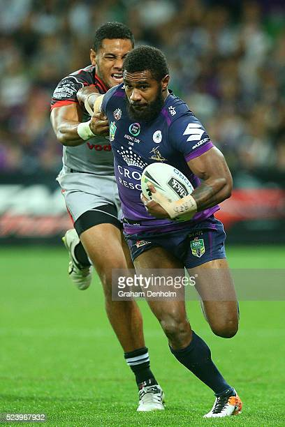 Marika Koroibete of the Storm breaks through a tackle during the round eight NRL match between the Melbourne Storm and the New Zealand Warriors at...