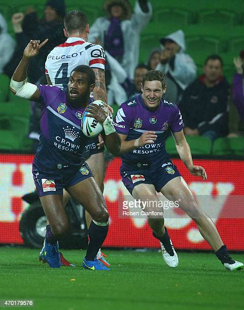 Marika Koroibete of the Storm celebrates after scoring a try during the round seven NRL match between the Melbourne Storm and the Sydney Roosters at...