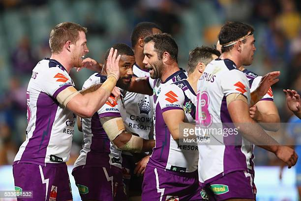 Marika Koroibete of the Storm celebrates with his team mates after scoring a try during the round 11 NRL match between the Parramatta Eels and the...