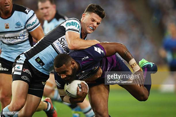 Marika Koroibete of the Storm is tackled Chad Townsend of the Sharks during the 2016 NRL Grand Final match between the Cronulla Sharks and the...
