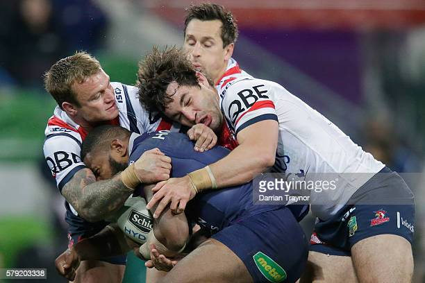 Marika Koroibete of the Storm is tackled during the round 20 NRL match between the Melbourne Storm and the Sydney Roosters at AAMI Park on July 23...