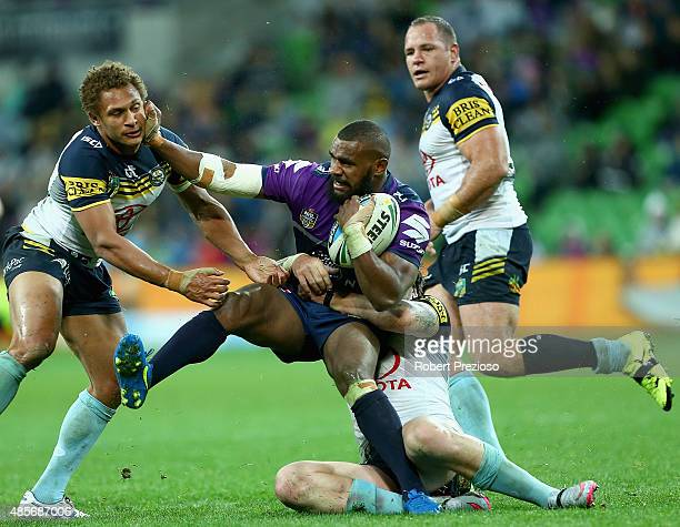 Marika Koroibete of the Storm is tackled during the round 25 NRL match between the Melbourne Storm and the North Queensland Cowboys at AAMI Park on...