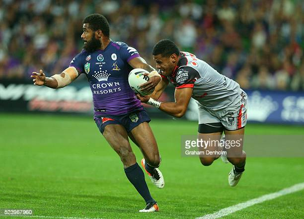 Marika Koroibete of the Storm is tackled during the round eight NRL match between the Melbourne Storm and the New Zealand Warriors at AAMI Park on...