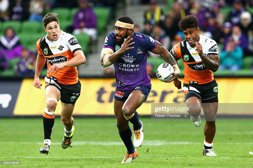 Marika Koroibete of the Storm runs during the round 16 NRL match between the Melbourne Storm and Wests Tigers at AAMI Park on June 26, 2016 in Melbourne, Australia.