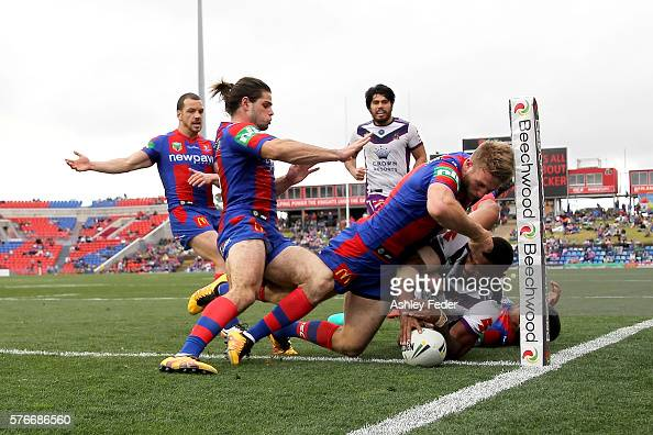 Marika Koroibete of the Storm scores a try during the round 19 NRL match between the Newcastle Knights and the Melbourne Storm at Hunter Stadium on...