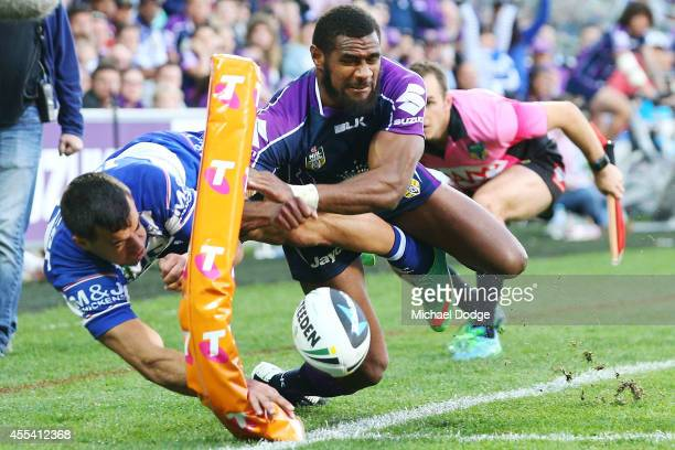 Marika Koroibete of the Storm stops Corey Thompson of the Bulldogs from scoring a try during the NRL 2nd Elimination Final match between the...