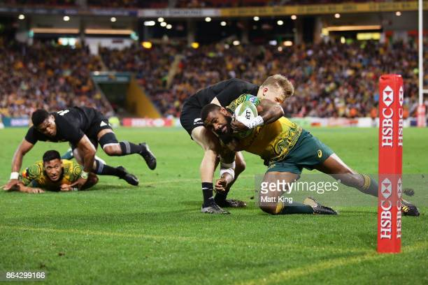 Marika Koroibete of the Wallabies beats Damian McKenzie of the All Blacks to score a try during the Bledisloe Cup match between the Australian...