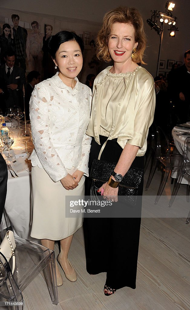 Mariko Mori (L) and <a gi-track='captionPersonalityLinkClicked' href=/galleries/search?phrase=Julia+Peyton-Jones&family=editorial&specificpeople=2130494 ng-click='$event.stopPropagation()'>Julia Peyton-Jones</a> attend the 'Arts For Life' charity auction hosted by Susan Hayden, Nadja Swarovski and Natalia Vodianova to raise funds for Borne, a research programme on premature birth, at the Saatchi Gallery on June 24, 2013 in London, England.