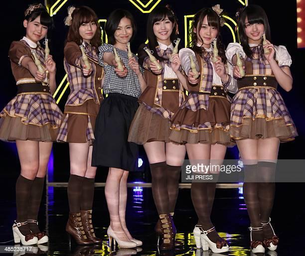 Mariko Tsukamoto a 37yearold housewife smiles as she poses with members of AKB48 after winning membership of 'Otona AKB48' in Yokohama suburban Tokyo...