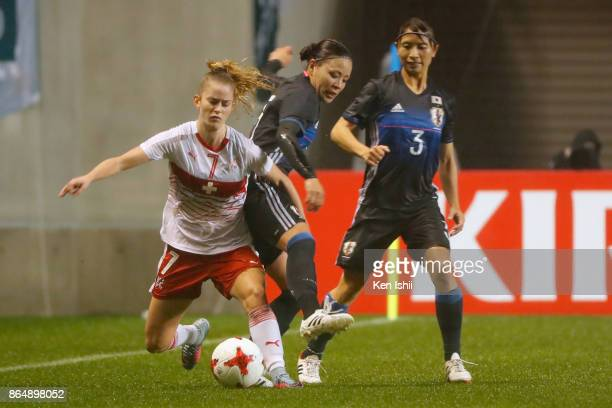 Marilena Widmer of Switzerland and Madoka Haji of Japan compete for the ball during the international friendly match between Japan and Switzerland at...