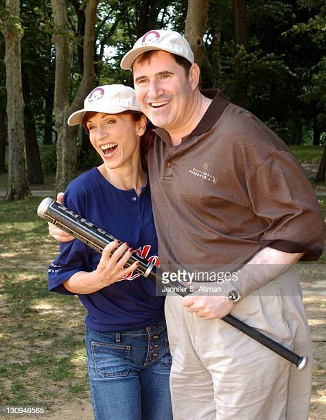 Marilu Henner and Richard Kind play with a bat before they throw a ceremonial first ball to begin the Broadway Softball League allstar and oldtimers...