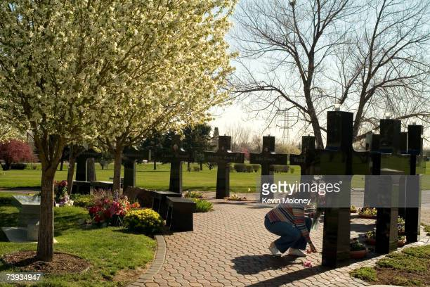 Marilyn Bell of Littleton CO leaves a flower each for the victims of the Columbine High School shootings in 1999 at a memorial at Chapel Hill...