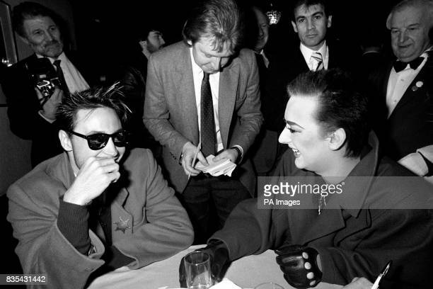 Marilyn left and Boy George shorn of their legendary long hair at the London Hilton where they attended the Variety Club of Great Britain's lunch and...