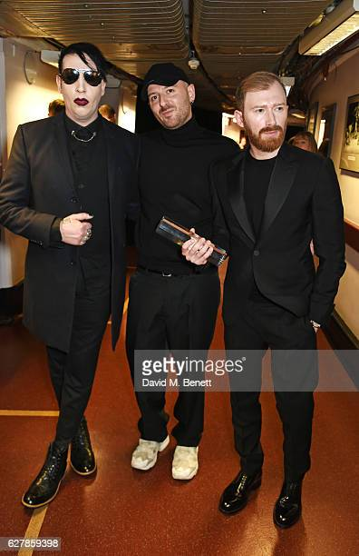 Marilyn Manson Demna Gvasalia and Guram Gvasalia winners of the International Urban Luxury Brand award pose backstage at The Fashion Awards 2016 at...