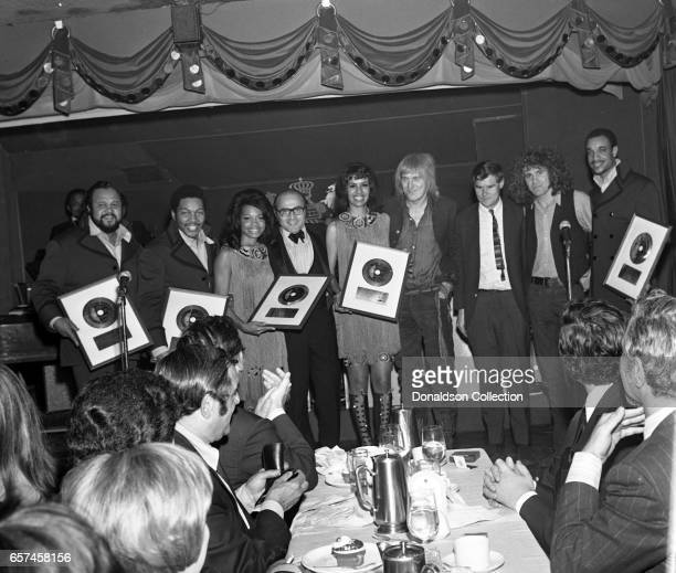 Marilyn McCoo Florence LaRue Billy Davis Jr LaMonte McLemore and Ron Townson of the vocal group '5th Dimension' at a Liberty UA Records party on May...