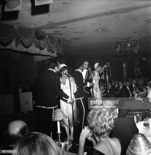 Marilyn McCoo Florence LaRue Billy Davis Jr LaMonte McLemore and Ron Townson of the vocal group '5th Dimension' perform onstage at the Americana...