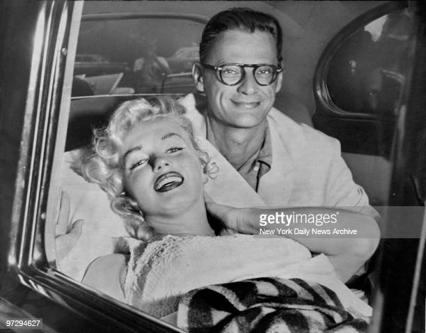 Marilyn Monroe and her husband Arthur Miller smile as she leaves Doctors Hospital East End Ave and E 88th St