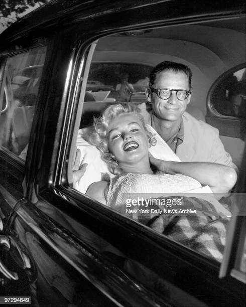 Marilyn Monroe and her husband Arthur Miller smile as she leaves Doctors Hospital But Marilyn was reported exhausted after losing her child which had...
