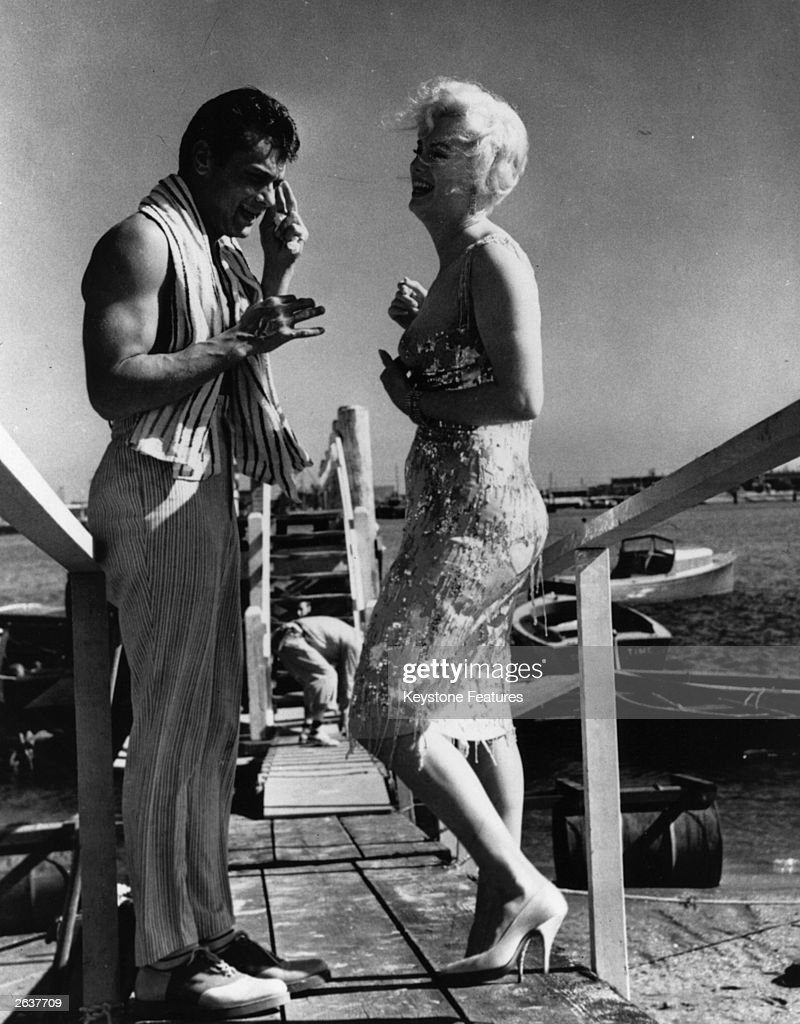 Marilyn Monroe (1926 - 1962) and Tony Curtis on the set of 'Some Like It Hot', directed by Billy Wilder for United Artists.