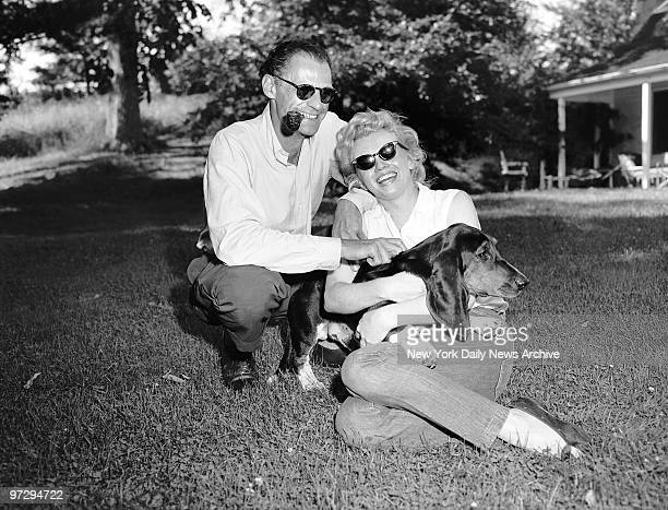Marilyn Monroe Arthur Miller and his dog Hugo at Miller's home in Roxbury CT
