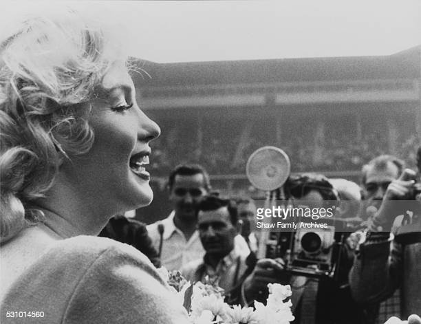 Marilyn Monroe at the ceremonial kick off for a match between a combined Israeli Hapoel team and the American Soccer League Stars at Ebbets Field in...