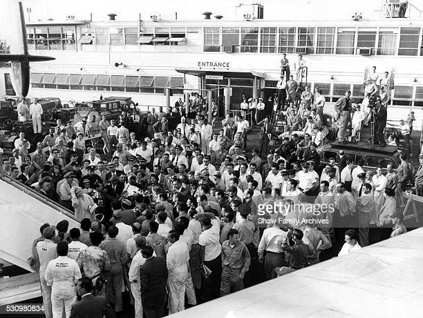 Marilyn Monroe descends the staircase of an airplane into a crowd after a TWA flight from Hollywood to Idlewild Airport in September 1954 in New York...