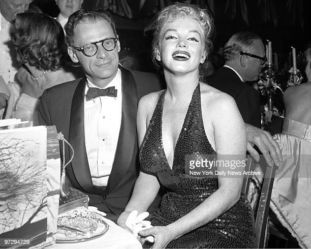 Marilyn Monroe glamourous as ever and her husband playwright Arthur Miller enjoy the festivites during the 'April in Paris' ball at WaldorfAstorida...