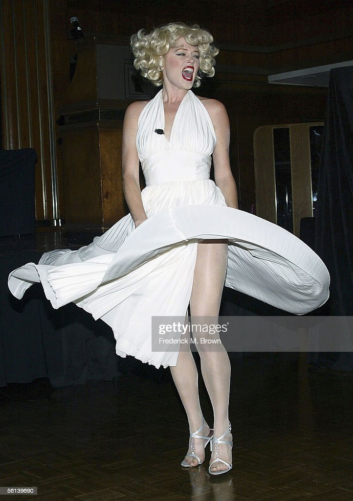 A Marilyn Monroe impersonator of the late actress Marilyn Monroe performs during the unveiling of the Marilyn Monroe Exhibit at the Queen Mary on November 10, 2005 in Long Beach, California. The exhibit will reach 35 locations on 6 continents. (Photo by Frederick M. Brown/Getty Images).