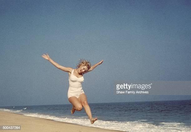 Marilyn Monroe jumping on the beach in 1957 in Amagansett New York