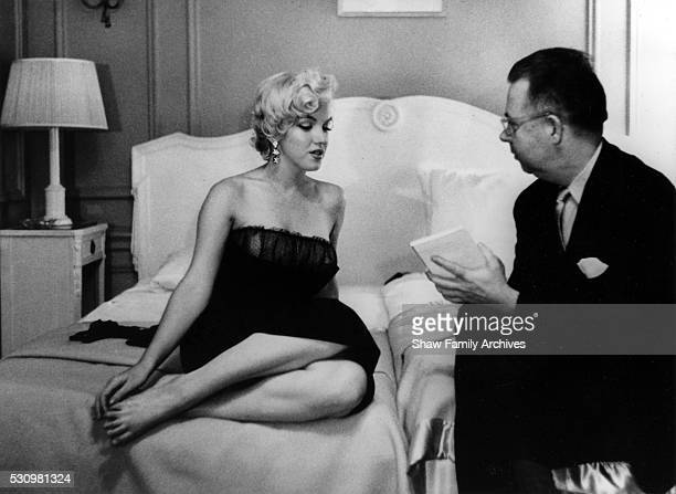 Marilyn Monroe speaks to a reporter at a press party for 'The Seven Year Itch' in 1954 in New York New York