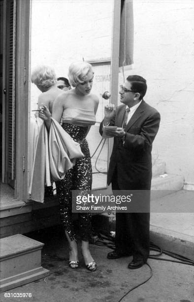 Marilyn Monroe talking to newspaper columnist Sidney Skolsky on set while working on the Dazzledent Toothpaste commercial sequence in 1954 for 'The...
