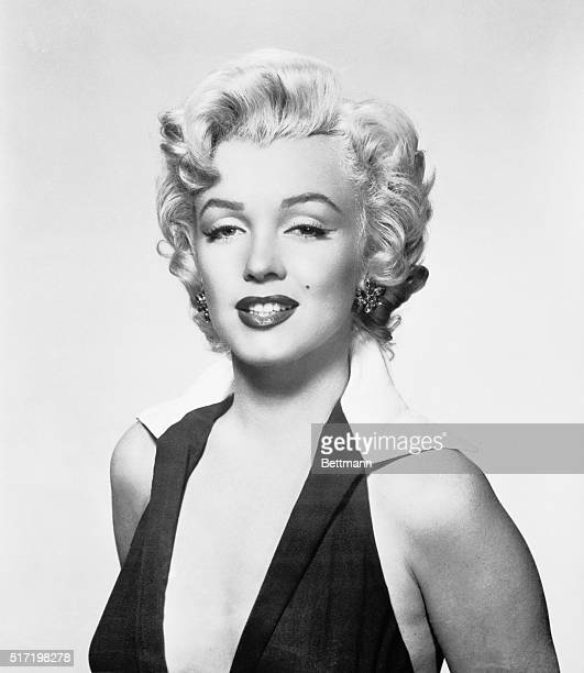 Marilyn Monroe wearing a halter dress in the shot made famous by artist Andy Warhol