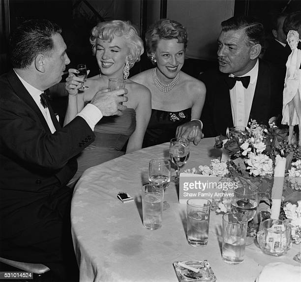 Marilyn Monroe with actor Clark Gable producer Charles K Feldman and actress Jean Howard at the wrap party for the filming of 'The Seven Year Itch'...