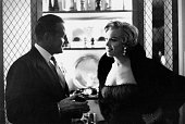 Marilyn Monroe with Bob Kriendler coowner of the '21' Club at a press party for 'The Seven Year Itch' at the '21' Club in 1954 in New York New York