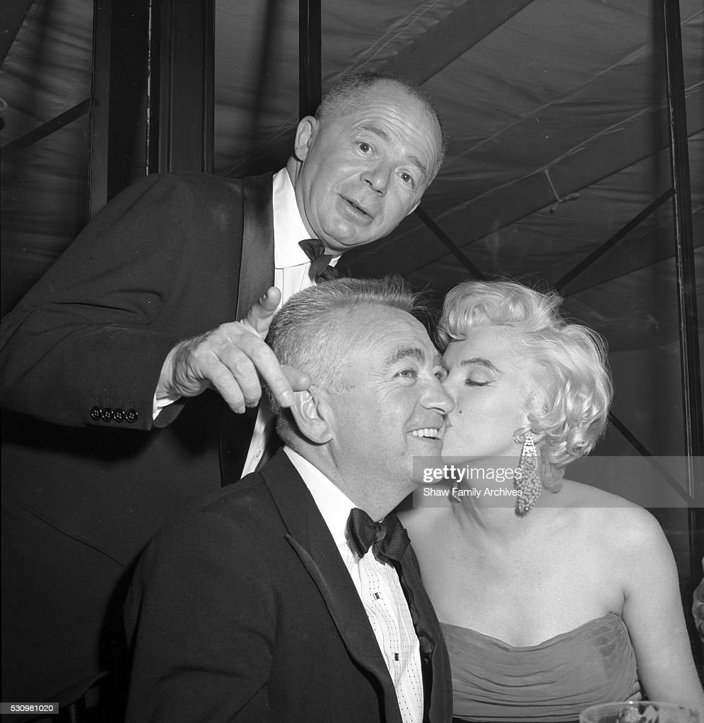 Marilyn Monroe with directors Billy Wilder and Charles Vidor at the wrap party for the filming of 'The Seven Year Itch' at Romanoff's Restaurant in 1954 in Los Angeles, California.