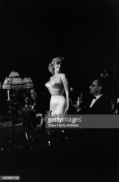 Marilyn Monroe with her husband the playwright Arthur Miller and New York City Mayor Robert Wagner in 1957 at the premiere for 'The Prince and the...