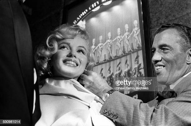 Marilyn Monroe with television host Ed Sullivan in 1957 at the premiere for 'The Prince and the Showgirl' at Radio City Music Hall in New York New...