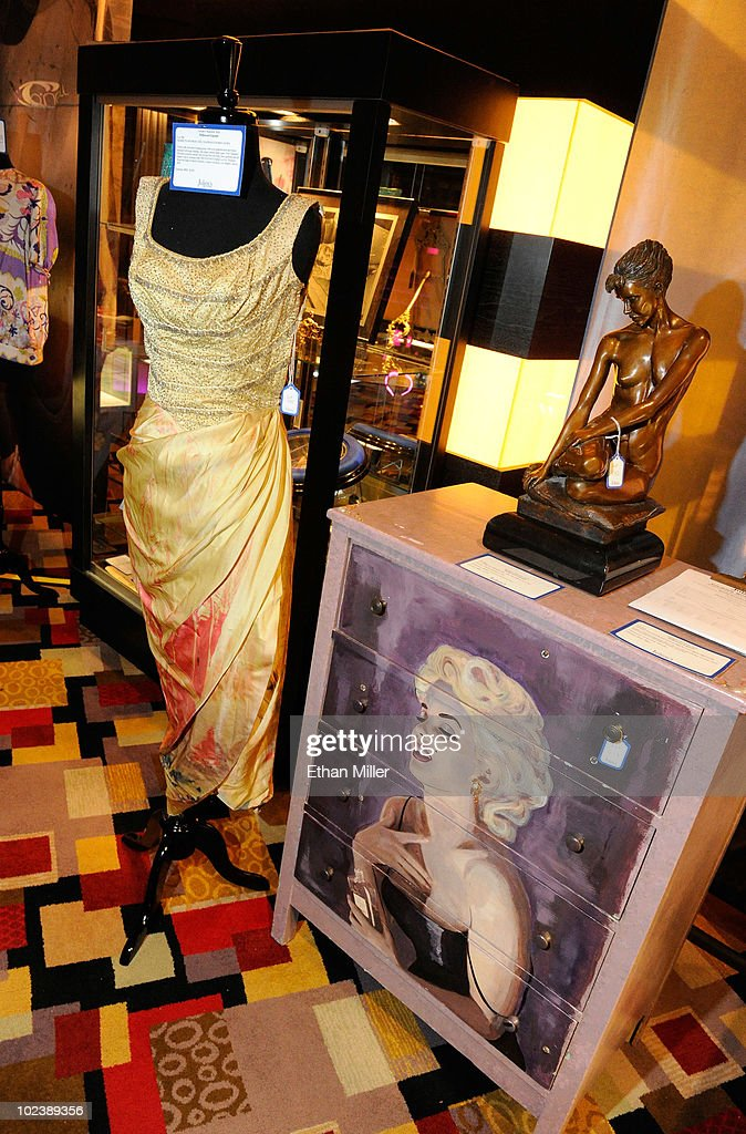 Marilyn Monroe's Ceil Chapman evening gown is displayed next to Anna Nicole Smith's custom painted Marilyn Monroe dresser at Julien's Auctions annual summer sale at the Planet Hollywood Resort & Casino June 24, 2010 in Las Vegas, Nevada. The auction, which continues through Sunday, features 1,600 items from entertainers including Michael Jackson, Anna Nicole Smith, Marilyn Monroe, Cher, Elvis Presley and Star Trek creator Gene Roddenberry. Part of the proceeds from Smith's auction items will be used to help in the upbringing her daughter Dannielynn Birkhead.