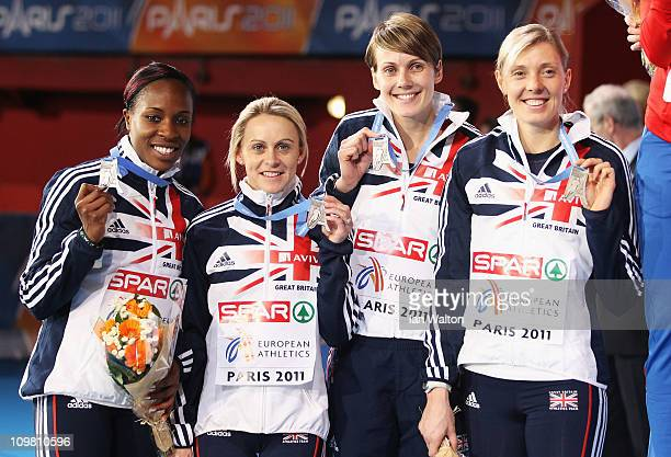 Marilyn Okoro Jennifer Meadows Kelly Sotherton and Lee McConnell of Great Britain and Northern Ireland pose with their silver medals after the 4x400m...