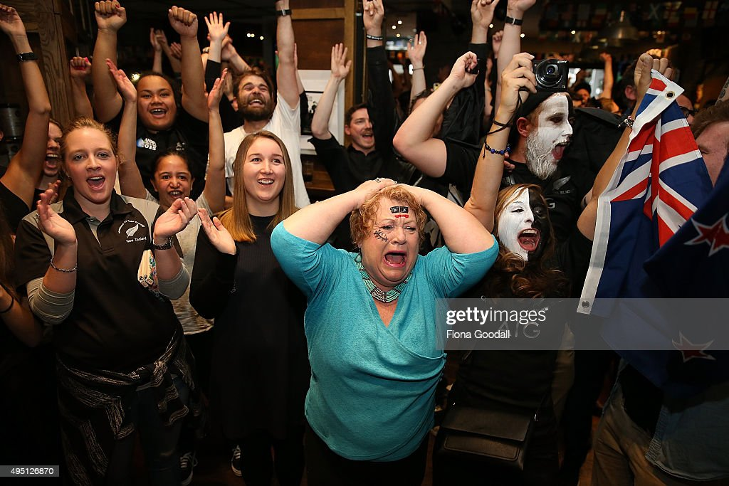 Marilynna Burton (C) celebrates with rugby fans at The Fox Sports Bar in Auckland watch the 2015 Rugby World Cup Final match between the New Zealand All Blacks and Australia Wallabies, on November 1, 2015 in Auckland, New Zealand.