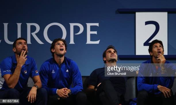 Marin Cilic Dominic Thiem Roger Federer and Fernando Verdasco of Team Europe watch Alexander Zverev of Team Europe during his singles match against...