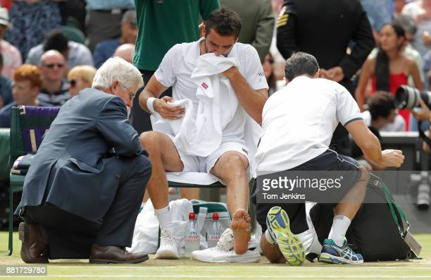 Marin Cilic gets treatment on his foot during the men's singles final on Centre Court on day thirteen of the 2017 Wimbledon tennis championships at...
