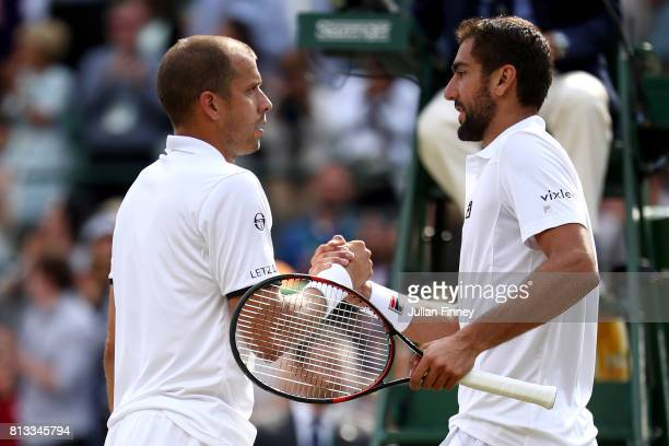 Marin Cilic of Croatia and Gilles Muller of Luxembourg shake hands after the Gentlemen's Singles quarter final match on day nine of the Wimbledon...