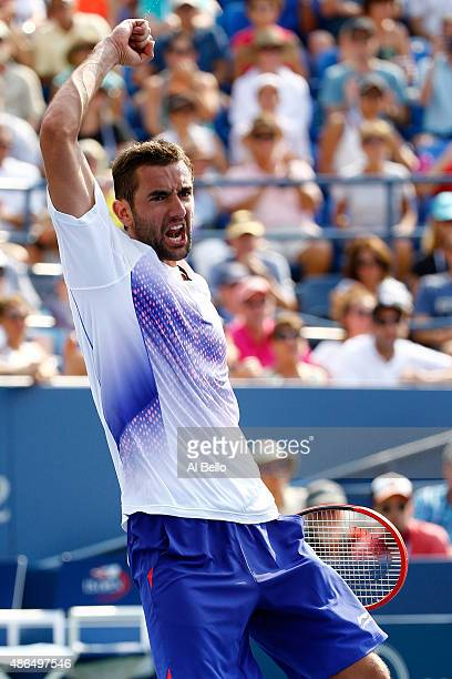 Marin Cilic of Croatia celebrates after defeating Mikhail Kukushkin of Kazakhstan in their Men's Singles Third Round match on Day Five of the 2015 US...