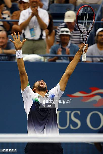 Marin Cilic of Croatia celebrates after defeating Roger Federer of Switzerland during their men's singles semifinal match on Day Thirteen of the 2014...